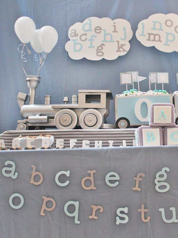 silver train birthday dessert table centerpiece