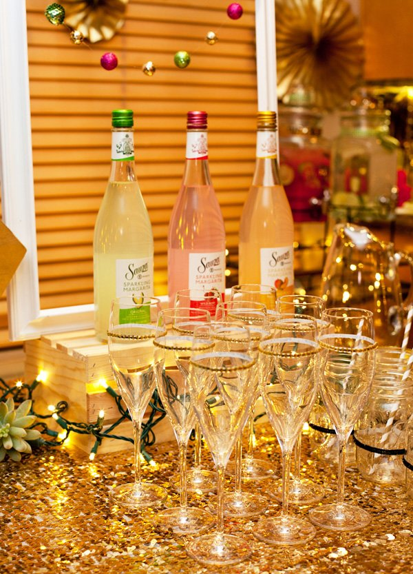 sauza's sparkling mixers were shown on display at the champagne bar with diy glitter flutes