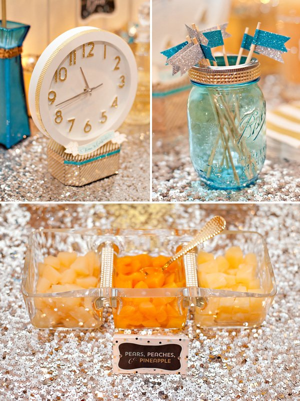 mix-ins on a sequined table with glitter party flags and a big white clock