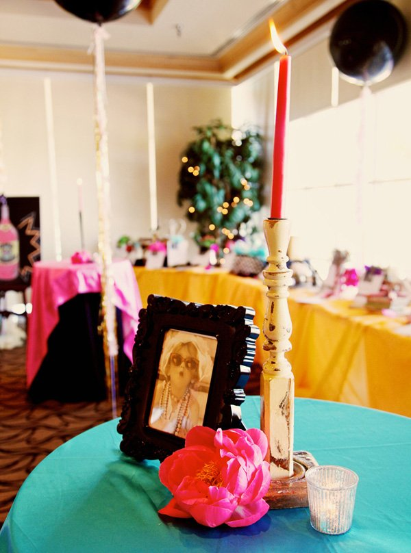 vintage paris table centerpieces with pink flowers, shabby chic candelabras and black picture frames