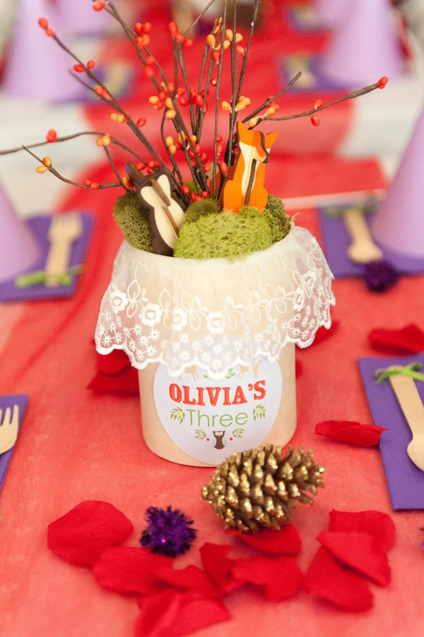 woodland animal birthday centerpieces with red berries, moss and lace
