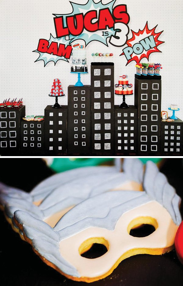 skyline desserts table and superhero mask cookie