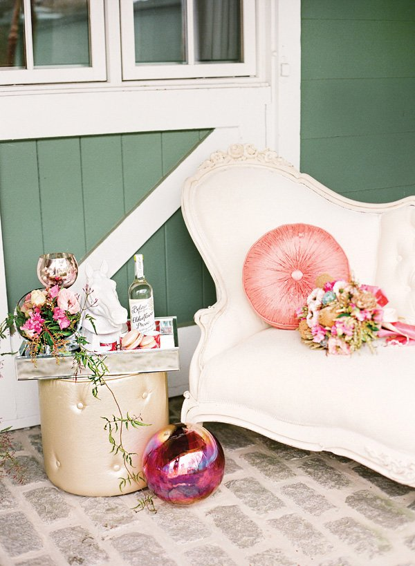 a romantic pink wedding lounge and drinks area