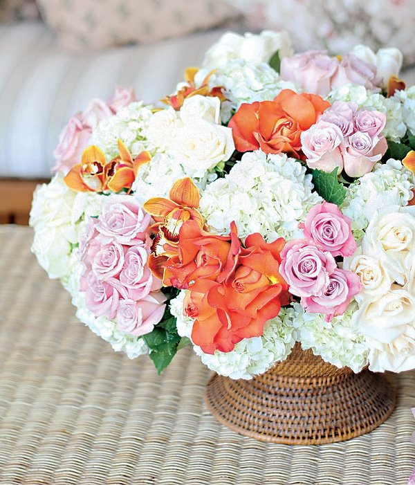 pink, white and orange rose and hydrangea floral arrangement