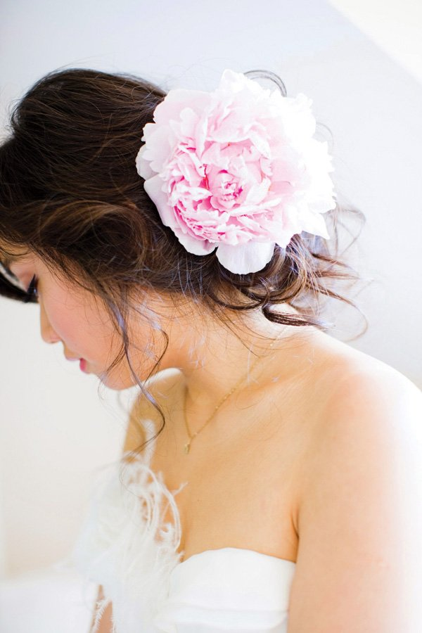 bridal photo of the bride's profile with a flower in her hair