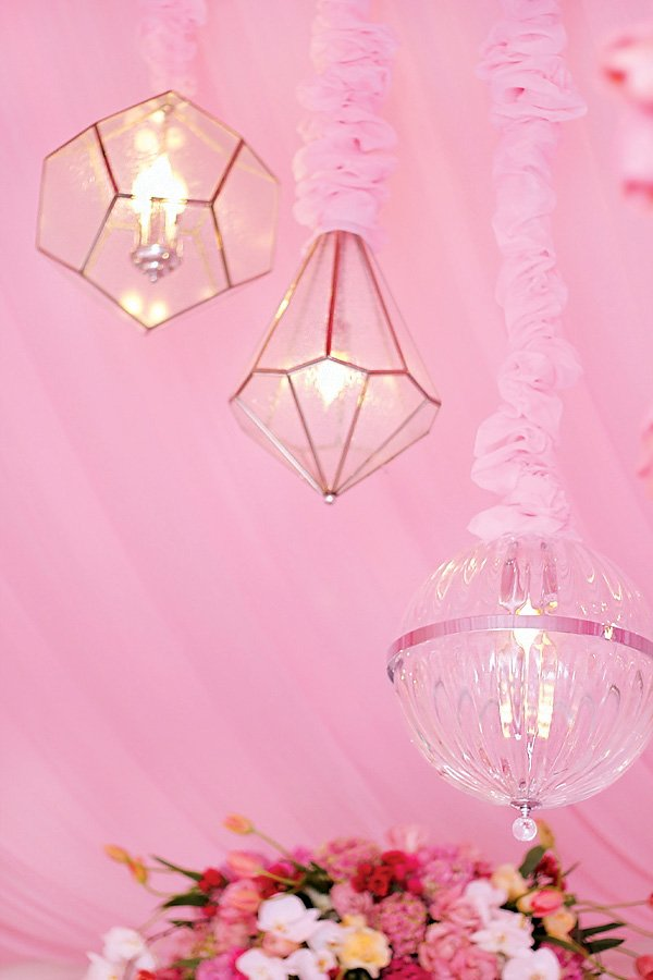hanging glass lanterns on the pink canopy tent