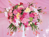 large pink and white flower arrangement with tulips and roses