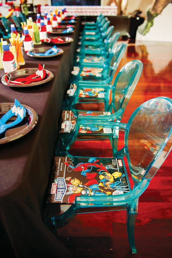 blue lucite kids chairs at the table