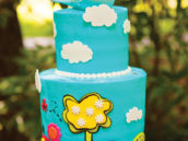 bird topped, cloud decorated sunny teal cake