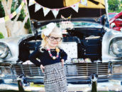 birthday girl photo in front of a classic car