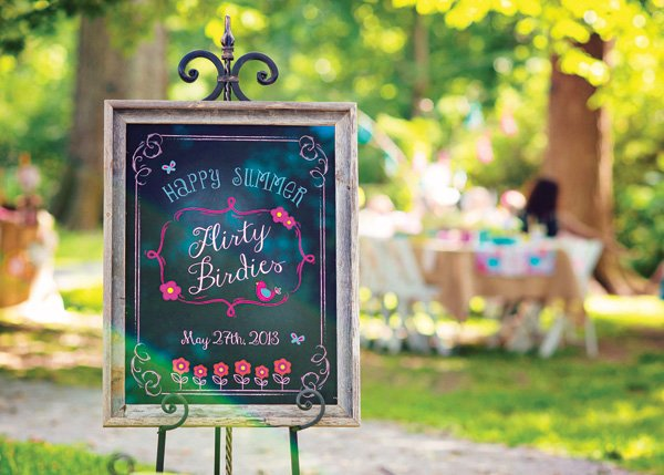 chalkboard welcome sign for an outdoor bid party