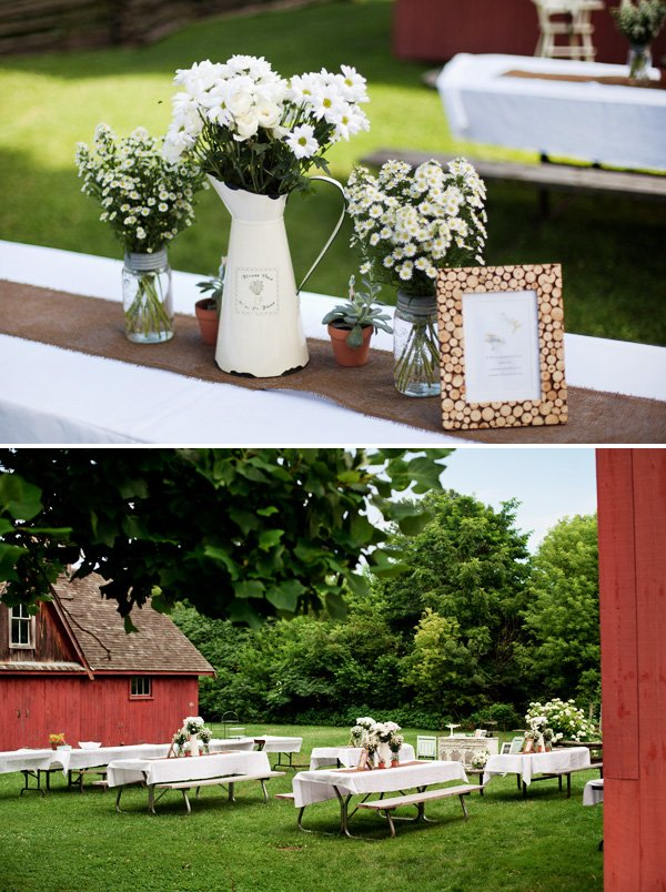 garden inspired daisy and watering can centerpieces