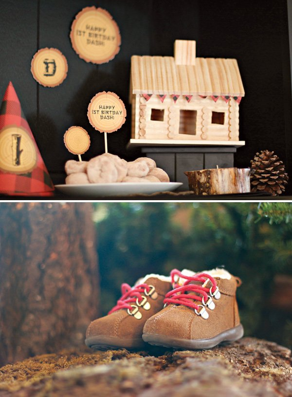 log cabin and baby snow boots for a first birthday party