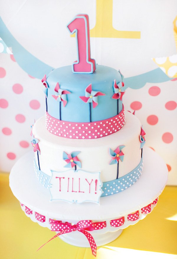 pink and blue pinwheel two tiered birthday cake