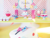 pinwheel and polka dot dessert table and smash cake