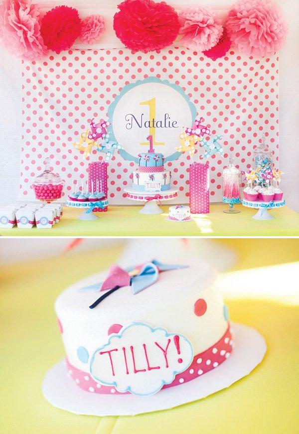 pinwheel and polka dot dessert table and smash cake