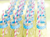 individual glass milk jars with polka dots and paper straws