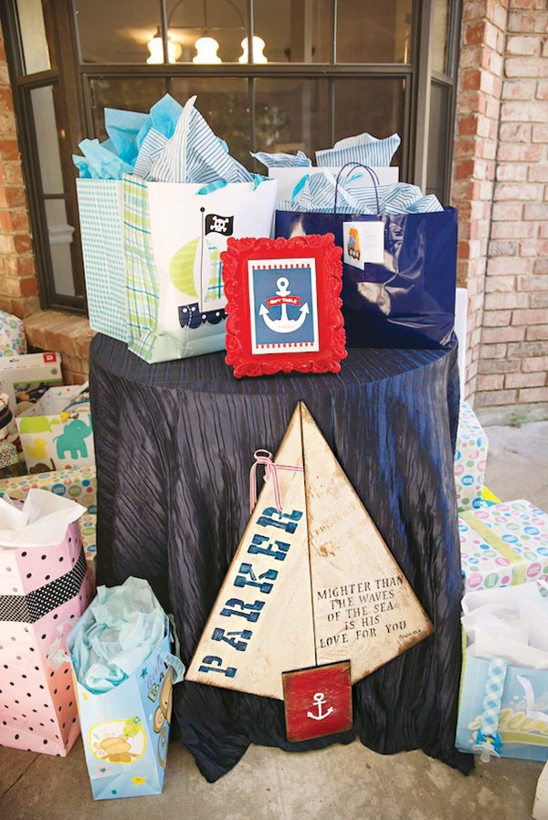 sailboat sign and gifts table
