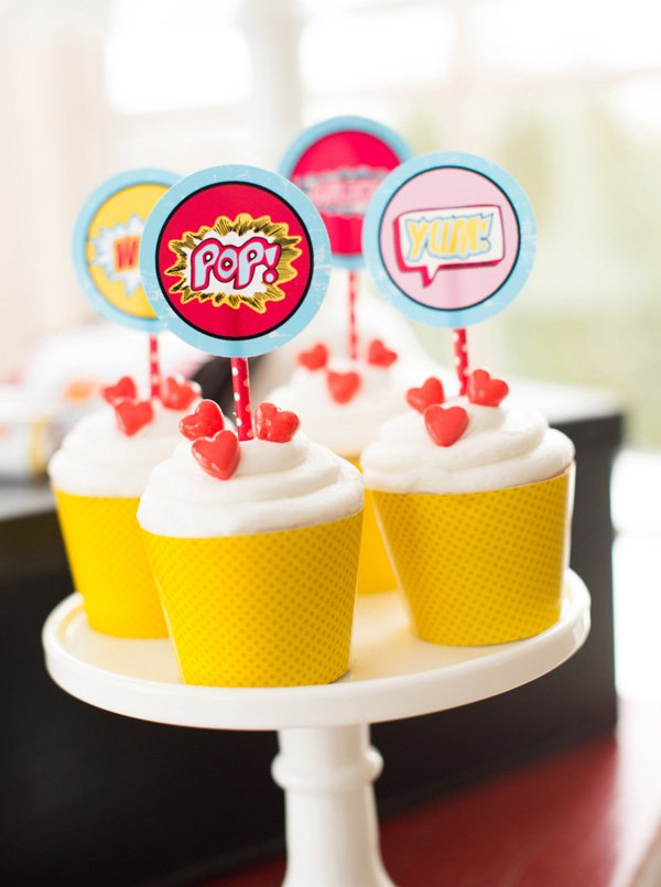 heart and comic book pop art topped cupcakes for a kid's valentine's day