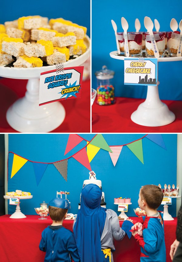 superhero party dessert table and individual cherry cheesecakes