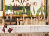 woodsy and rustic welcome sign mirror and fireplace