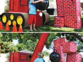kids play wrecking ball and crane with cardboard brick walls