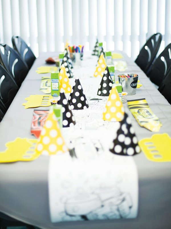 yellow and black decorated kids table for a school bus birthday party