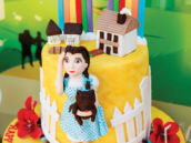 wizard of oz dorothy and rainbow topped cake