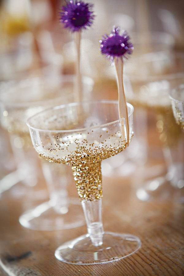 DIY glitter champagne glass with pom stirrer