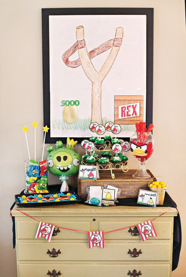 angry birds birthday party dessert table with DIY backdrop