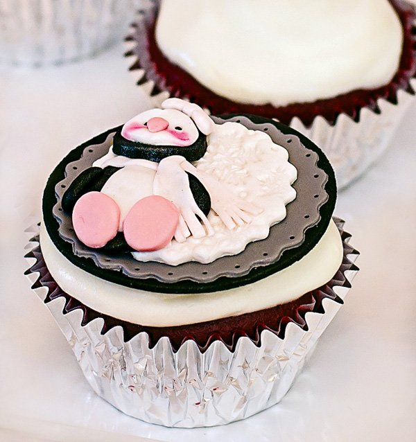 cute baby penguin topped cupcake