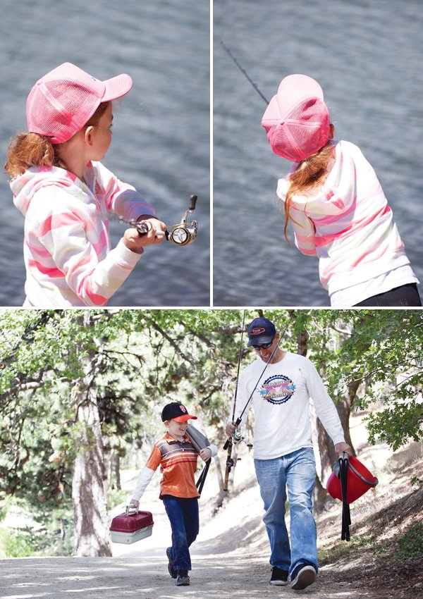 family fishing at an outdoors lake party