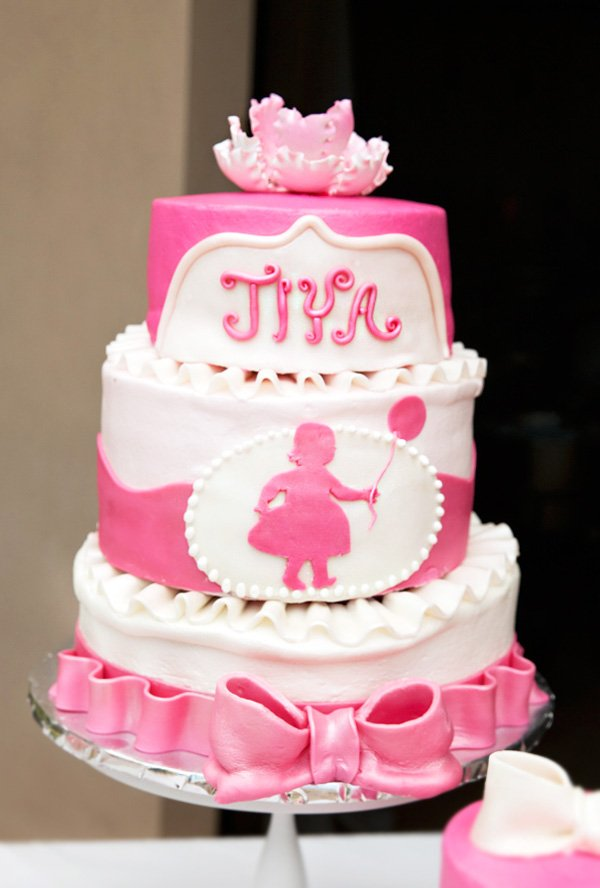 pink bow and balloon first birthday cake