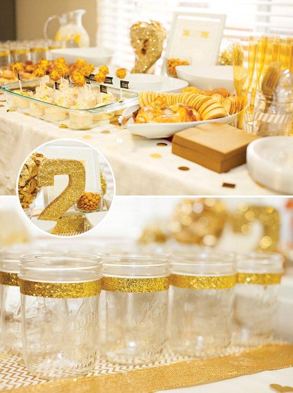 gold glitter ribbon mason jars and food table