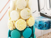 teal, white, gold and black macaron tower