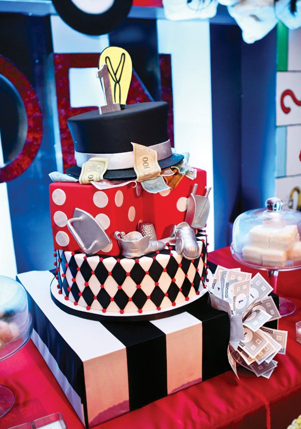 monopoly man inspired cake with top hat tier and monopoly money