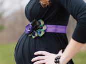 pregnant mother's belly photo with pretty peacock feather and ribbon belt