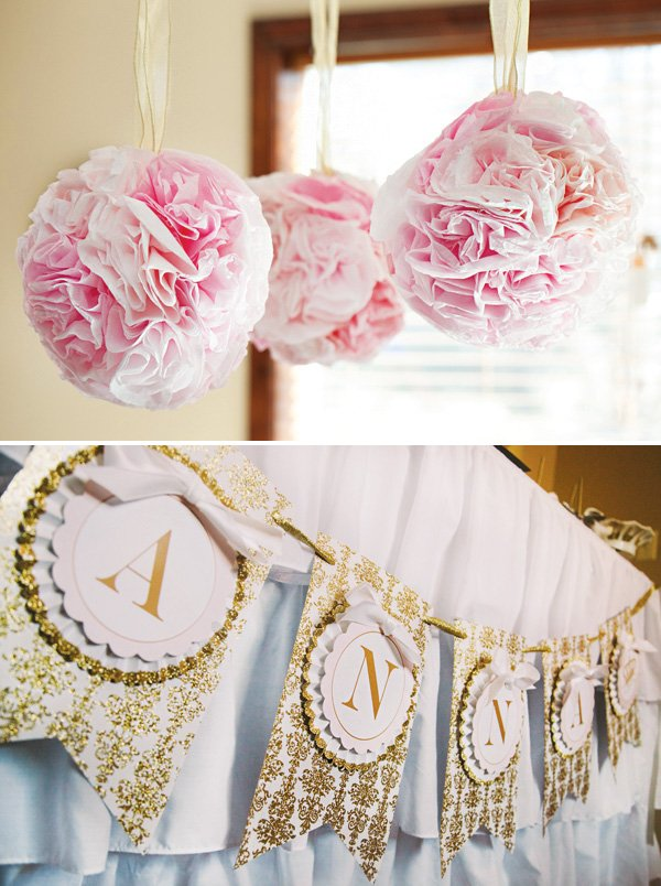 pink and gold birthday party banner and poms