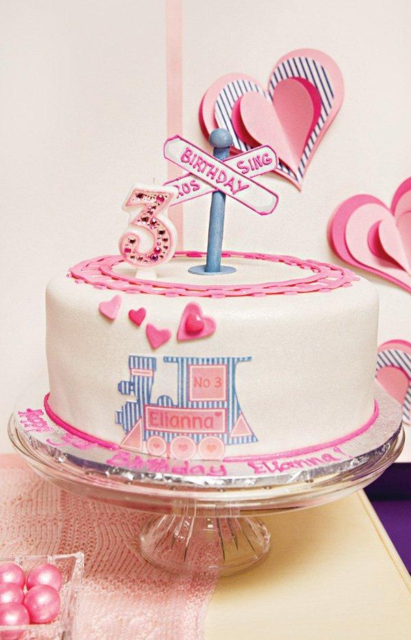 girl's pink railroad train birthday cake