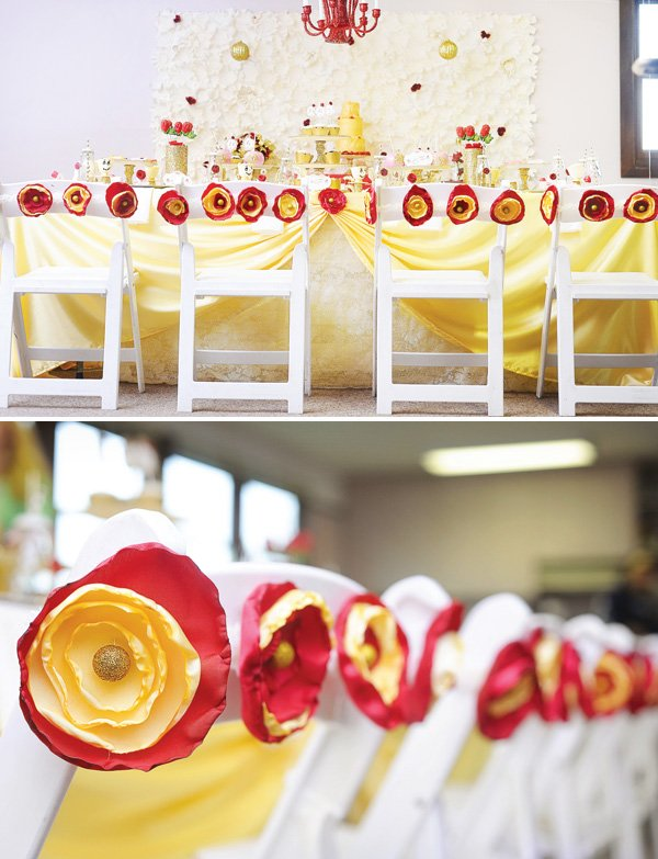 red and yellow roses decorate the princess party table