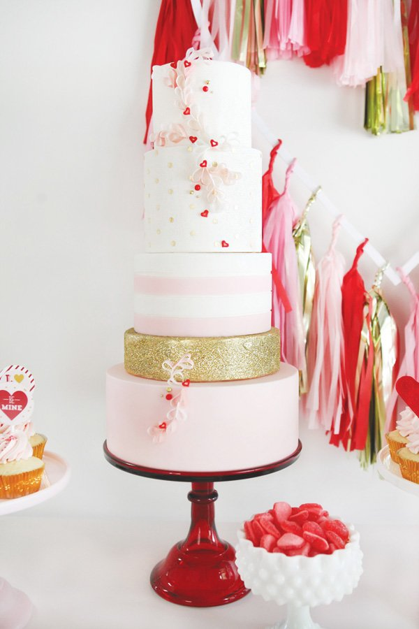 valentine's day multi tiered cake with fondant heart wreath and gold glitter