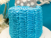 bow tie topped blue ruffle smash cake