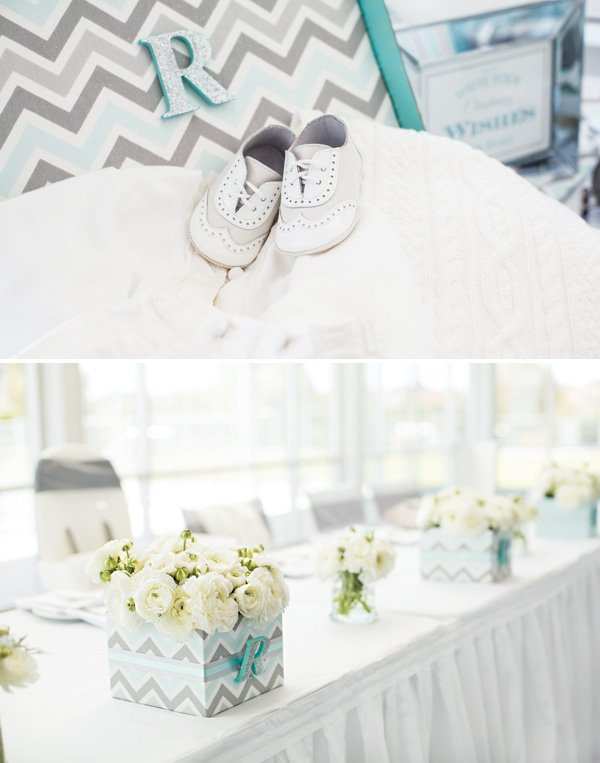 boy's christening celebration outfit and floral arrangements