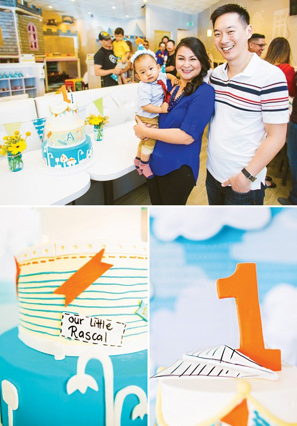 boys first birthday party cake and family photo