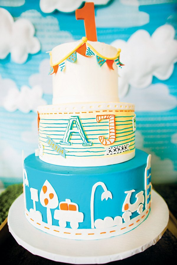 boys travel and notebook paper themed first birthday cake