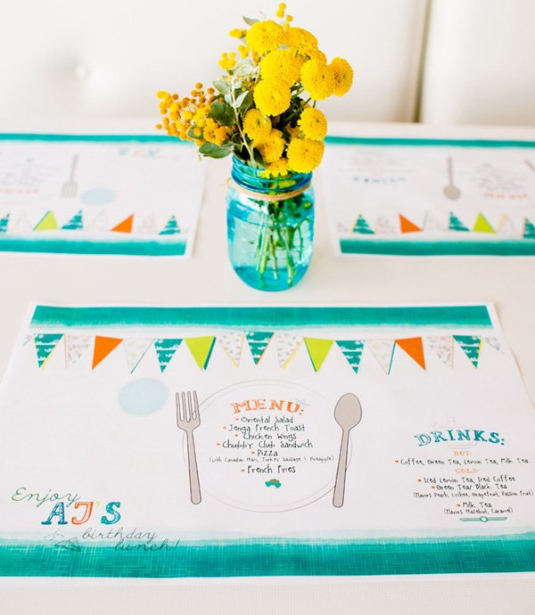 brightly colored kids place setting and flowers