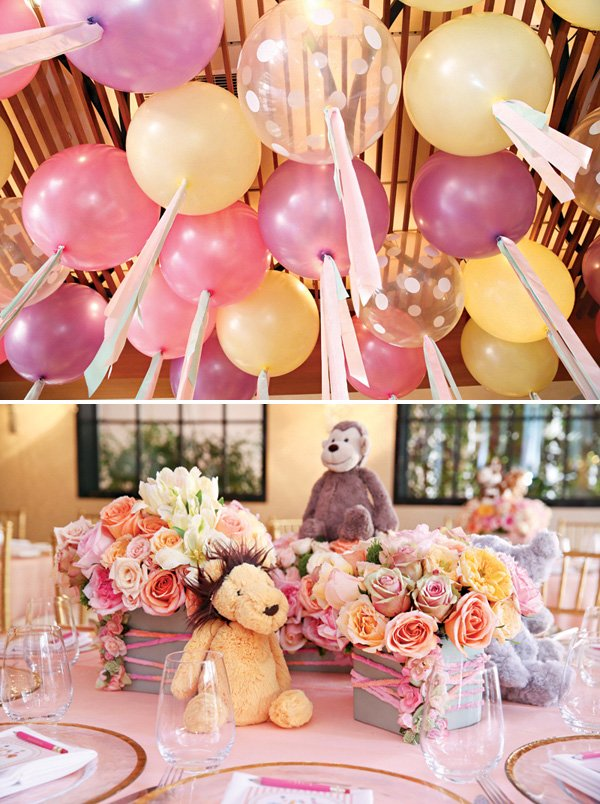 large ceiling balloons and rose bouquet centerpieces