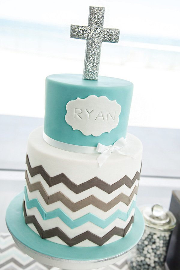 chevron striped christening cake topped with a silver glitter cross topper