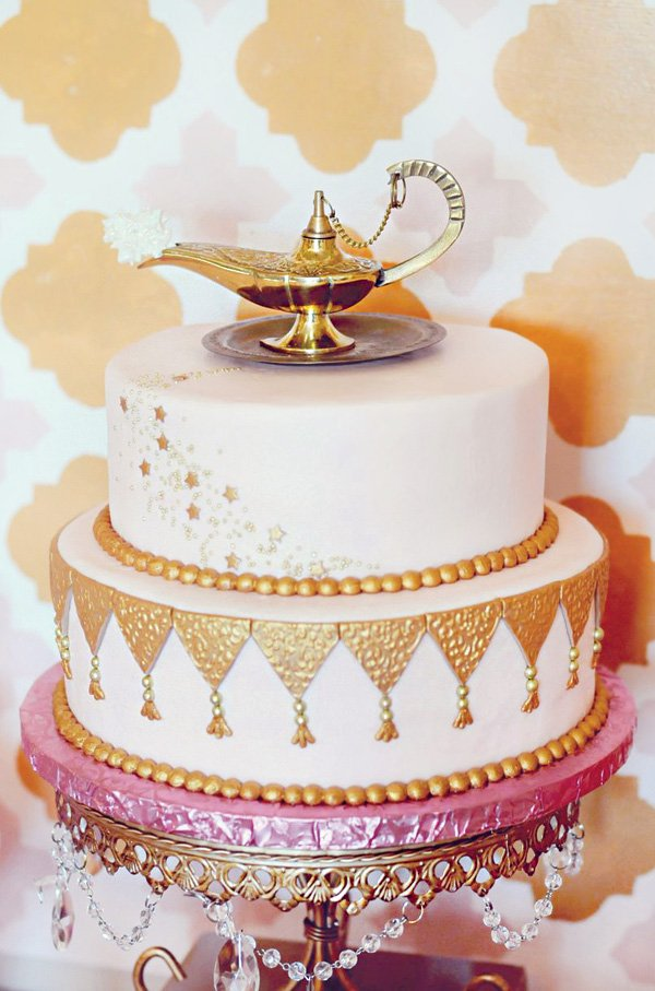 gold genie lamp topped birthday cake