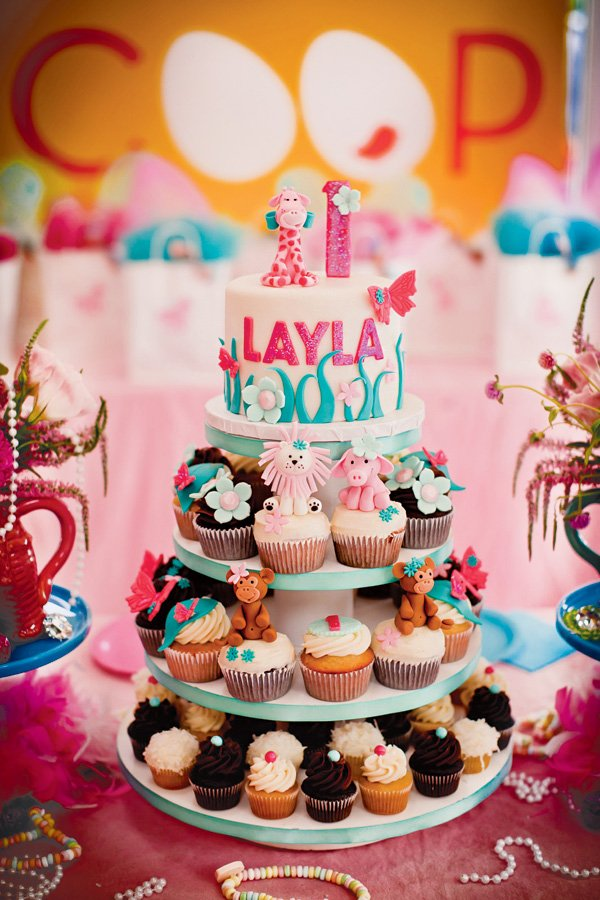 girly jungle animal smash cake and cupcake tower